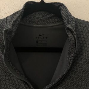 Long sleeve dry fit quarter zip up Nike jacket.